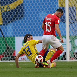 July 3, 2018 - Russia - July 03, 2018, St. Petersburg, FIFA World Cup 2018 Football, the playoff round. Football match of Sweden - Switzerland at the stadium of St. Petersburg. Player of the national team Gustav Svensson; Blerim Jemali. (Credit Image: © Russian Look via ZUMA Wire)