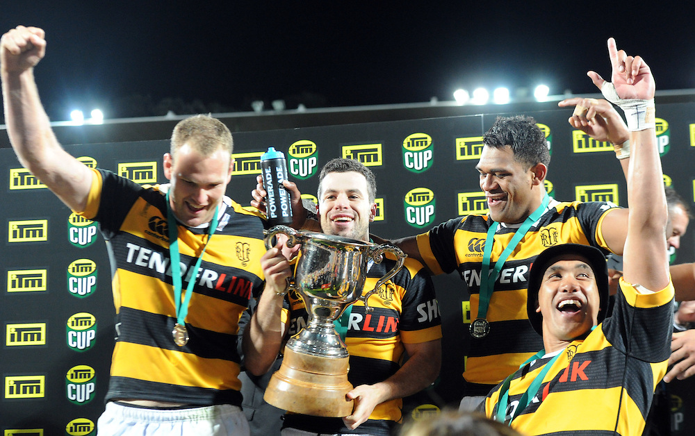 Taranaki's James Marshall, centre, with team mates with the trophy after defeating Tasman Makos in the ITM Cup Rugby Premiership final match at Yarrow Stadium, New Plymouth, New Zealand, Saturday, October 25, 2014. Credit:SNPA / Ross Setford