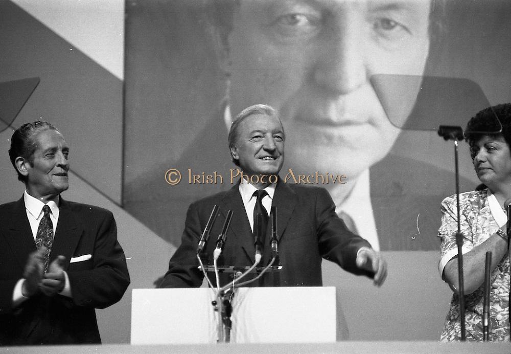 Fianna Fáil Ard Fheis.  (R97)..1989..25.02.1989..02.25.1989..25th February 1989..The Fianna Fáil Ard Fheis was held today at the RDS Main Hall, Ballsbridge, Dublin. An Taoiseach, Charles Haughey TD,gave the keynote speech of the event...An Taoiseach, Charles Haughey TD, is pictured as he takes place at the podium, he is accompanied by An Tanaiste, Brian Lenihan and Minister Máire Geoghegan-Quinn