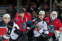 KELOWNA, CANADA - MARCH 16: Tristen Nielsen #8 and Owen Hardy #15 of the Vancouver Giants check Kaedan Korczak #6 and Dalton Gally #3 in front of the net of Roman Basran #30 of the Kelowna Rockets on March 16, 2019 at Prospera Place in Kelowna, British Columbia, Canada.  (Photo by Marissa Baecker/Shoot the Breeze)
