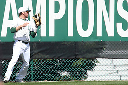 14 April 2013:  Zach Scott pulls in a long fly ball while standing just short of the outfield fence during an NCAA division 3 College Conference of Illinois and Wisconsin (CCIW) Baseball game between the Elmhurst Bluejays and the Illinois Wesleyan Titans in Jack Horenberger Stadium, Bloomington IL