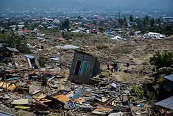 Oct. 2, 2018 -  Palu, Indonesia - Debris of houses in Balaroa village after earthquake and tsunami in Palu, Central Sulawesi, Indonesia. The death toll of Indonesia's multiple powerful quakes that triggered tsunami in Central Sulawesi province on Friday soared to 1,249 people with 799 others sustaining serious injuries, a governmental disaster official said here on Tuesday.  (Credit Image: © Iqbal Lubis/Xinhua via ZUMA Wire)