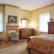 CREAM RIDGE, NJ - OCTOBER 29, 2016: The third bedroom on the second floor has a wood burning stove, views of the property and a door to the master bedroom to the left. 92 Holmes Mill Rd, Cream Ridge, NJ. Credit: Albert Yee for the New York Times