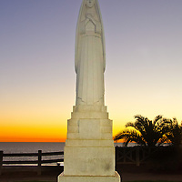 The Public art sculpture entitled, 'Santa Monica' (by 1934 by Eugene H. Monrahan) amid the last sunset of Fall 2012, at Palisades Park on Thursday, December 20, 2012.