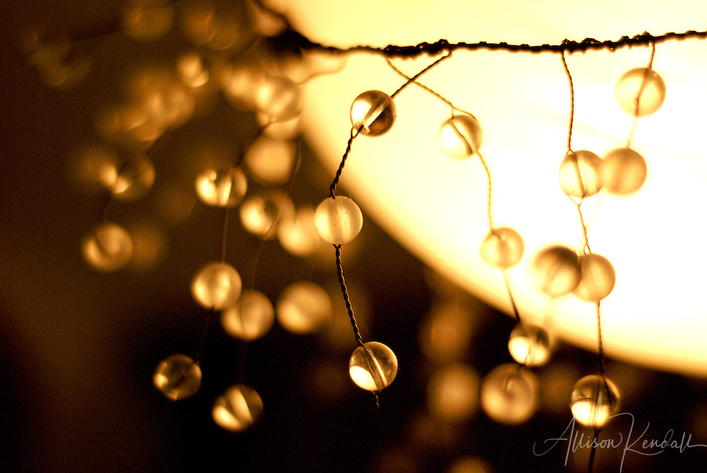 A simple decoration of glass spheres and wire transforms a light fixture
