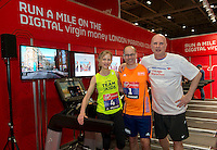 (LTR) Mary Wittenberg (New York City Marathon Race Director), Hugh Brasher (Virgin Money London Marathon Race Director) & Carey Pinkowski (Chicago Marathon Race Director) Pictured after running the worlds first  Digital Marathon at the official race Expo, ExCeL centre London.<br /> <br /> Friday 11th of April 2014<br /> <br /> FREE PICTURE USAGE<br /> PR picture distributed by London Marathon<br /> No reproduction fee<br /> <br /> FFI Contact <br /> Penny Dain 07799170433 <br /> Pennyd@london-marathon.co.uk<br /> <br /> Excel Exhibition Centre<br /> The Virgin Money London Marathon 2014<br /> 11 April 2014. <br /> <br /> Photo: Tom Lovelock/Virgin Money London Marathonmedia@london-marathon.co.uk