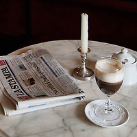 TURIN, ITALY - MAY 28: La Stampa and a Bicerin, the historic hot drink from Turin, which is a mixture of espresso, drinking chocolate and fresh cream carefully layered in a glass on May 28, 2010 in Turin, Italy. The traditional recipe was created around 1750 in a cafe in front of the entrance of the Santuario della Consolata, where it is still served to this day.  (Photo by Marco Secchi/Getty Images)