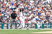 DETROIT, MI - JULY 9: Austin Jackson #14 of the Detroit Tigers is safe at third ahead of throw to Juan Uribe #5 of the Los Angeles Dodgers during the interleague game at Comerica Park on July 9, 2014 in Detroit, Michigan. (Photo by Joe Robbins)