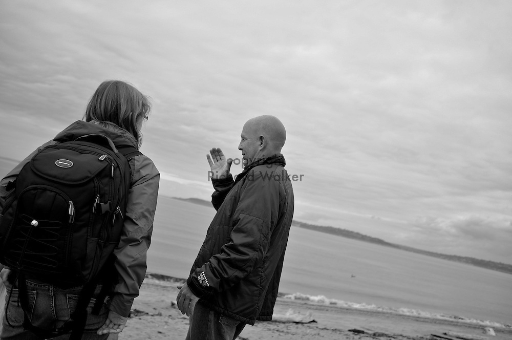 2011 September 14 - A man gestures at Alki Beach, Seattle, WA, USA. Copyright Richard Walker