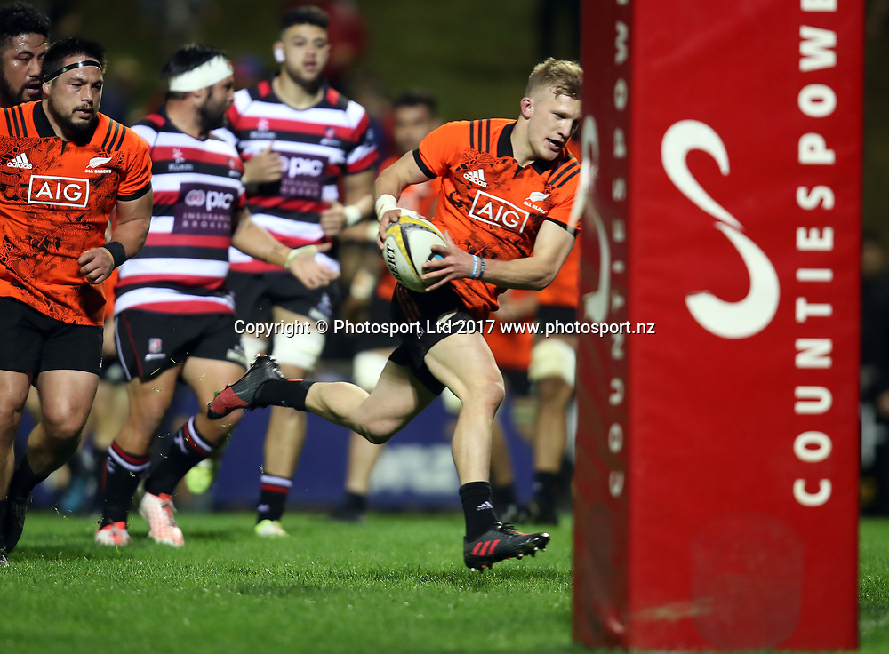 Damian McKenzie on his way to score a try. Game of Three Halves, All Blacks v Taranaki & Counties Manukau, ECOLight Stadium Pukekohe, Friday 11th August 2017. © Copyright photo: Shane Wenzlick / www.photosport.nz