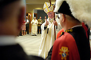 GREETING KNIGHTS -- Archbishop Timothy M. Dolan waves to Knights of Columbus color guard members at the beginning of a dedication Mass at St. Gabriel Church in Richfield, Wis. (Catholic Herald photo  by Sam Lucero)