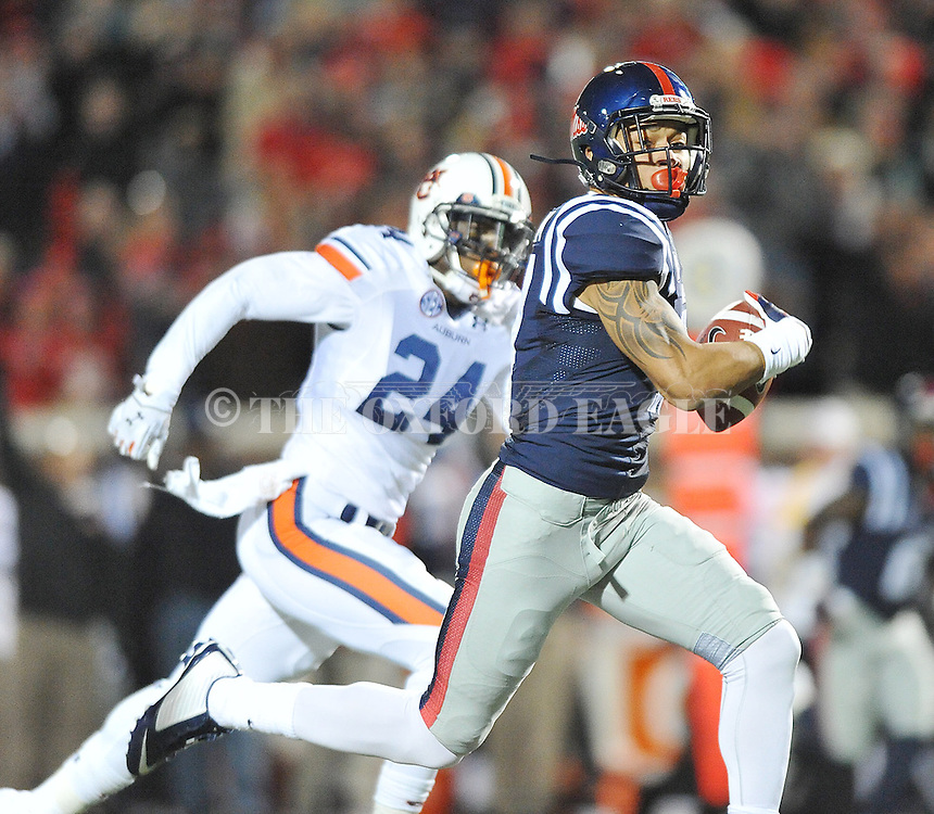Ole Miss' tight end Evan Engram (17) scores as Auburn Tigers' defensive back Derrick Moncrief (24) chases at Vaught-Hemingway Stadium in Oxford, Miss. on Saturday, November 1, 2014. Auburn won 35-31.(AP Photo/Oxford Eagle, Bruce Newman)