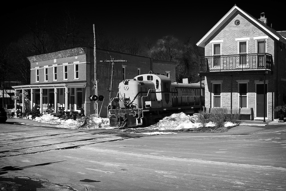 The small village of Shushan provides a timeless New England scene for the classic RS-3 to pass through. Trailing the locomotive, is one empty car bound for the interchange at Eagle Bridge.