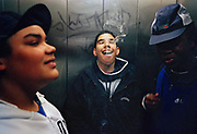 G.B. ENGLAND. London. Boys smoke cannabis in a lift, Lambeth Walk. 2002.