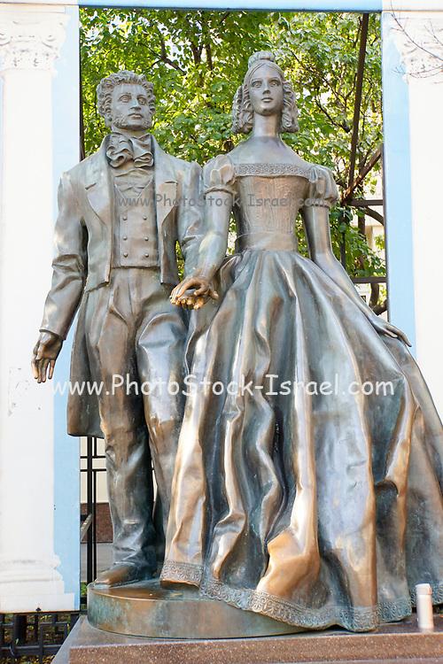 Bronze statue of Alexander Pushkin and Natalya Goncharova by Alexander Bourganov Old Arbat street Moscow Russia