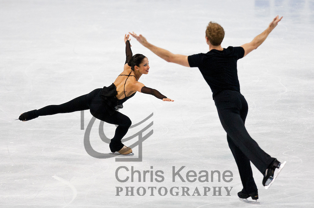 Mark Ladwig (R) skates with his partner Amanda Evora (L) in their pairs practice session during the U.S. Figure Skating Championships in Greensboro, North Carolina on January 25, 2011. REUTERS/Chris Keane (UNITED STATES)