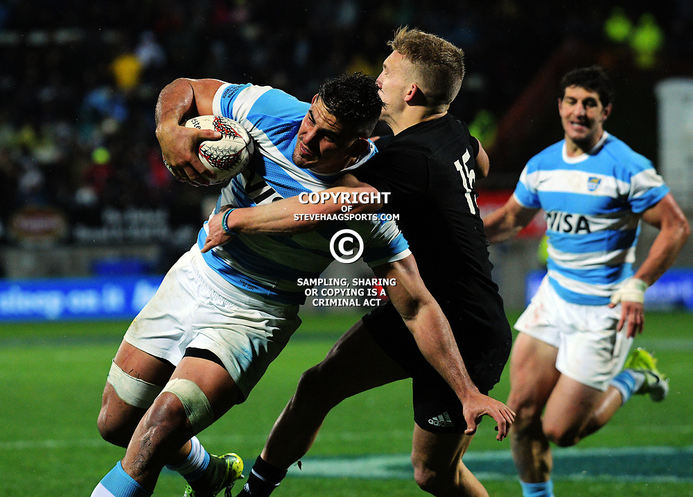 Damien McKenzie tackles Pablo Matera during the Rugby Championship match between the NZ All Blacks and Argentina Pumas at Yarrow Stadium in New Plymouth, New Zealand on Saturday, 9 September 2017. Photo: Dave Lintott / lintottphoto.co.nz