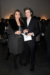 IMOGEN HERVEY-BATHURST and WILL PERROTT at a private view of photographs by Guido Mocafico entitled 'Guns and Roses' held at Hamiltons Gallery, 13 Carlos Place, London W1 on 21st January 2010.