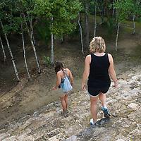 Women descending stairs at the Mayan ruins at Coba.