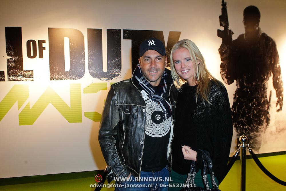 NLD/Amsterdam/20111107- Lancering Call of Duty MW3, Theo Nabuurs, Menthal Theo en partner Maaike Jansen