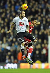 Korey Smith of Bristol City challenges for the header with Bradley Johnson of Derby County - Mandatory byline: Dougie Allward/JMP - 15/12/2015 - Football - iPro Stadium - Derby, England - Derby County v Bristol City - Sky Bet Championship