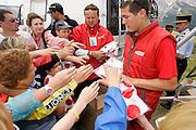 Souvenir hunters at the Tour de France 2005 reach out for their free polka dot T-shirt