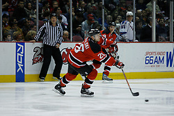 Feb 20, 2007; East Rutherford, NJ, USA; New Jersey Devils defenseman Brian Rafalski (28) moves the puck forward during the second period at Continental Airlines Arena in East Rutherford, NJ.