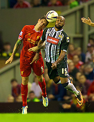 27.08.2013, Anfield, Liverpool, ENG, League Cup, FC Liverpool vs Notts County FC, 2. Runde, im Bild Liverpool's Daniel Agger and Notts County's Yoann Arquin during the English League Cup 2nd round match between Liverpool FC and Notts County FC, at Anfield, Liverpool, Great Britain on 2013/08/27. EXPA Pictures © 2013, PhotoCredit: EXPA/ Propagandaphoto/ David Rawcliffe<br /> <br /> ***** ATTENTION - OUT OF ENG, GBR, UK *****