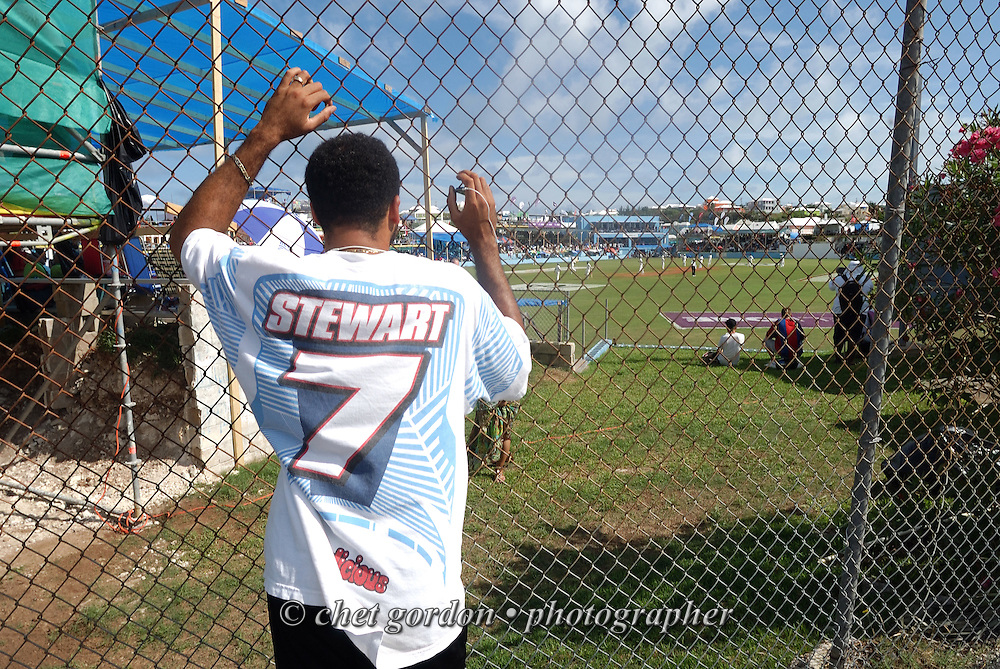 A man watches the first day of Cup Match between the St. George's and Somerset Cricket Clubs at the St. George's Cricket Club in St. George's, Bermuda on Thursday, July 28, 2011. The 109th. Annual Cup Match takes place during the two day public holidays of Emancipation Day and Somers Day in Bermuda.