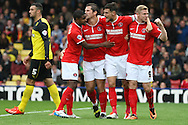 Picture by David Horn/Focus Images Ltd +44 7545 970036<br /> 14/09/2013<br /> Yann Kermorgant of Charlton Athletic (3rd right) celebrates scoring the opening goal with team mates during the Sky Bet Championship match at Vicarage Road, Watford.