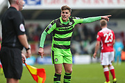 Forest Green Rovers Charlie Cooper(20) disputes the assistant referee's decision during the Vanarama National League match between Forest Green Rovers and Wrexham FC at the New Lawn, Forest Green, United Kingdom on 18 March 2017. Photo by Shane Healey.
