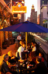 Stock photo of a group of people receiving their appetizers at an outdoor patio table at Cabo in downtown Houston Texas