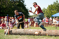 """Billy Kunelius from Barrington and Matthew """"Buckwheat"""" Taylor from Peru, ME compete in the Log Rolling event during the 2012 Bicentennial Woodsman Competition on Sunday.  (Karen Bobotas/for the Laconia Daily Sun)"""