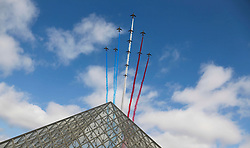 © Licensed to London News Pictures. 14/07/2015. Paris, FRANCE.  Patrouille de France (The Acrobatic Patrol of France) fly over the Louvre in Paris on Bastille Day, 14, July 2015. Photo credit: Jason Bryant/LNP