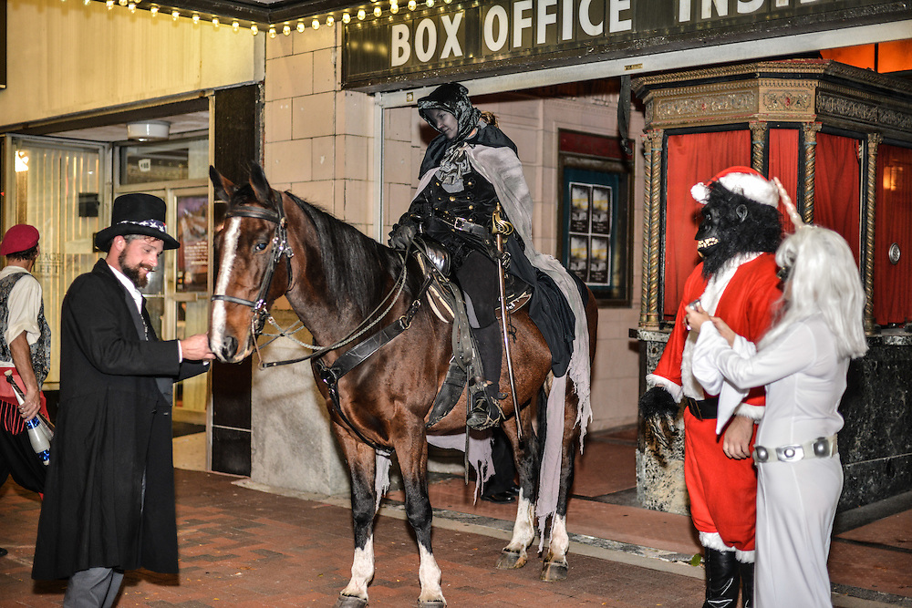 Guests arrive on horseback to The Masque of the Red Death Halloween event at The Akron Civic Theatre on October 25, 2014 .