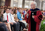 Ohio University College of Business Dean Hugh Sherman addresses incoming freshmen during the College of Business Freshman Convocation at Nelson Commons on Aug. 23, 2014. Photo by Lauren Pond