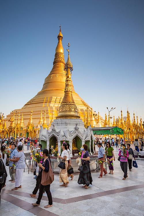 Pilgrims parading around Schwedagon Paya, Yangon, Myanmar