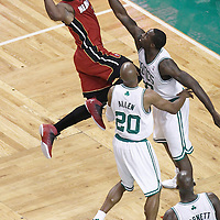 07 June 2012: Miami Heat shooting guard Dwyane Wade (3) looks to pass the ball over Boston Celtics power forward Brandon Bass (30) and Boston Celtics shooting guard Ray Allen (20) during first half of Game 6 of the Eastern Conference Finals playoff series, Heat at Celtics at the TD Banknorth Garden, Boston, Massachusetts, USA.
