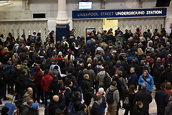 © Licensed to London News Pictures. 05/02/2014. London, UK. Crowds of people wait for Liverpool Street Underground Station to open at 7am today, 5th February 2014. London Underground union members from the RMT and TSSA unions have gone on a 48 hour strike, which started at 9pm on 4th February 2014, over proposals by Transport for London (TfL) to cut jobs and close ticket offices. Photo credit : Vickie Flores/LNP