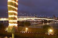 DEU, Germany, Cologne, view from the district Deutz to the Deutzer bridge across the river Rhine, illuminated folded sunshade.....DEU, Deutschland, Koeln, Blick vom Stadtteil Deutz zur Deutzer Bruecke ueber den Rhein, beleuchteter zusammengeklappter Sonnenschirm...