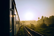 Shortly after sunrise, the sunlight illuminates the carriages of the Kandy to Ella train in Sri Lanka.