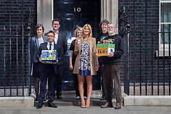 © licensed to London News Pictures. London, UK 09/05/2013. Made in Chelsea's Cheska Hull (centre) and Fairtrade campaigners hand over a petition to Number 10, Downing Street, calling for the government to support global food security. Fairtrade campaigners and members of The Co-operative are asking the government to use the G8 summit to unlock greater support for smallholder farmers. Photo credit: Tolga Akmen/LNP