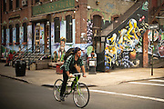 A guy rides a bike on Morgan Avenue in Bushwick, Broolyn, New York, 2011.
