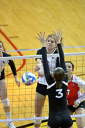 13 October 2011: Emily Schneider slams the ball past Samantha Kersting during an NCAA volleyball match between the Indiana State Sycamores and the Illinois State Redbirds at Redbird Arena in Normal Illinois.