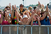 Young music fans at the barrier, Glastonbury Festival 2010