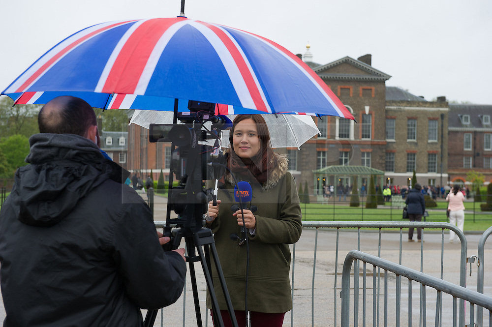 © London News Pictures. 03/04/15. London, UK. The world's media report from Kensington Palace as they away the announcement of the new royal Princess's name, Central London. Photo credit: Laura Lean/LNP