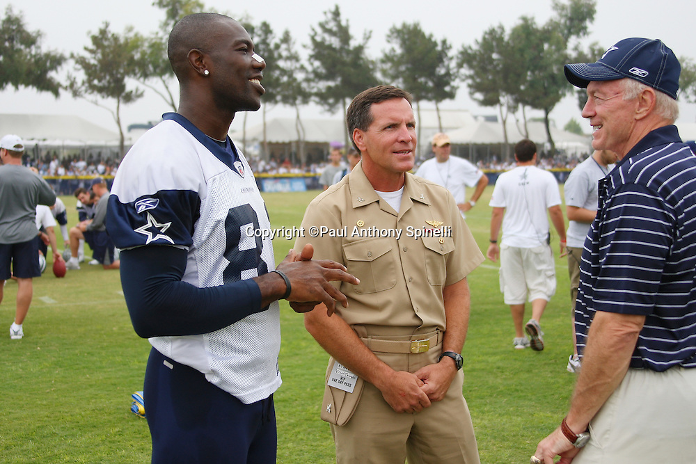 "OXNARD, CA - AUGUST 01:  Team Owner, President and General Manager Jerry Jones (right) of the Dallas Cowboys and wide receiver Terrell Owens #81 (left) of the Dallas Cowboys talk to Captain Brad ""Brick"" Conners, the Commanding Officer of the Naval Base Ventura County, during a break in the action at the 2008 Dallas Cowboys Training Camp at River Ridge Field in Oxnard, California on August 1, 2008. ©Paul Anthony Spinelli *** Local Caption *** Jerry Jones;Terrell Owens;Brad Conners"