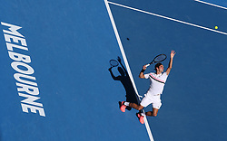 MELBOURNE, Jan. 22, 2018  Roger Federer of Switzerland serves during the men's singles fourth round match against Marton Fucsovics of Hungary at Australian Open 2018 in Melbourne, Australia, Jan. 22, 2018. Roger Federer won 3-0. (Credit Image: © Bai Xuefei/Xinhua via ZUMA Wire)