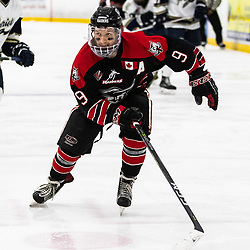 TORONTO, ON - APR 10, 2018: Ontario Junior Hockey League, South West Conference Championship Series. Game seven of the best of seven series between the Georgetown Raiders and the Toronto Patriots, Jordan Crocker #9 of the Georgetown Raiders follows the play during the third period.<br /> (Photo by Kevin Raposo / OJHL Images)