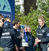 Putney, GREAT BRITAIN,   Oxford celebrate with the trophy after winning the  2009 Boat Race, at Mortlake,  Sun.29.03.2009. [Mandatory Credit, Peter Spurrier / Intersport-images]..Oxford Crew, Bow, Michal PLOTKOWIAK, Colin SMITH, Alex HEARNE, Ben HARRISON, Sjoerd HAMBURGER, Tom SOLESBURY, George BRIDGEWATER, Ante KUSURIN and cox Colin GROSHONG. . Rowing Course: River Thames, Championship course, Putney to Mortlake 4.25 Miles,